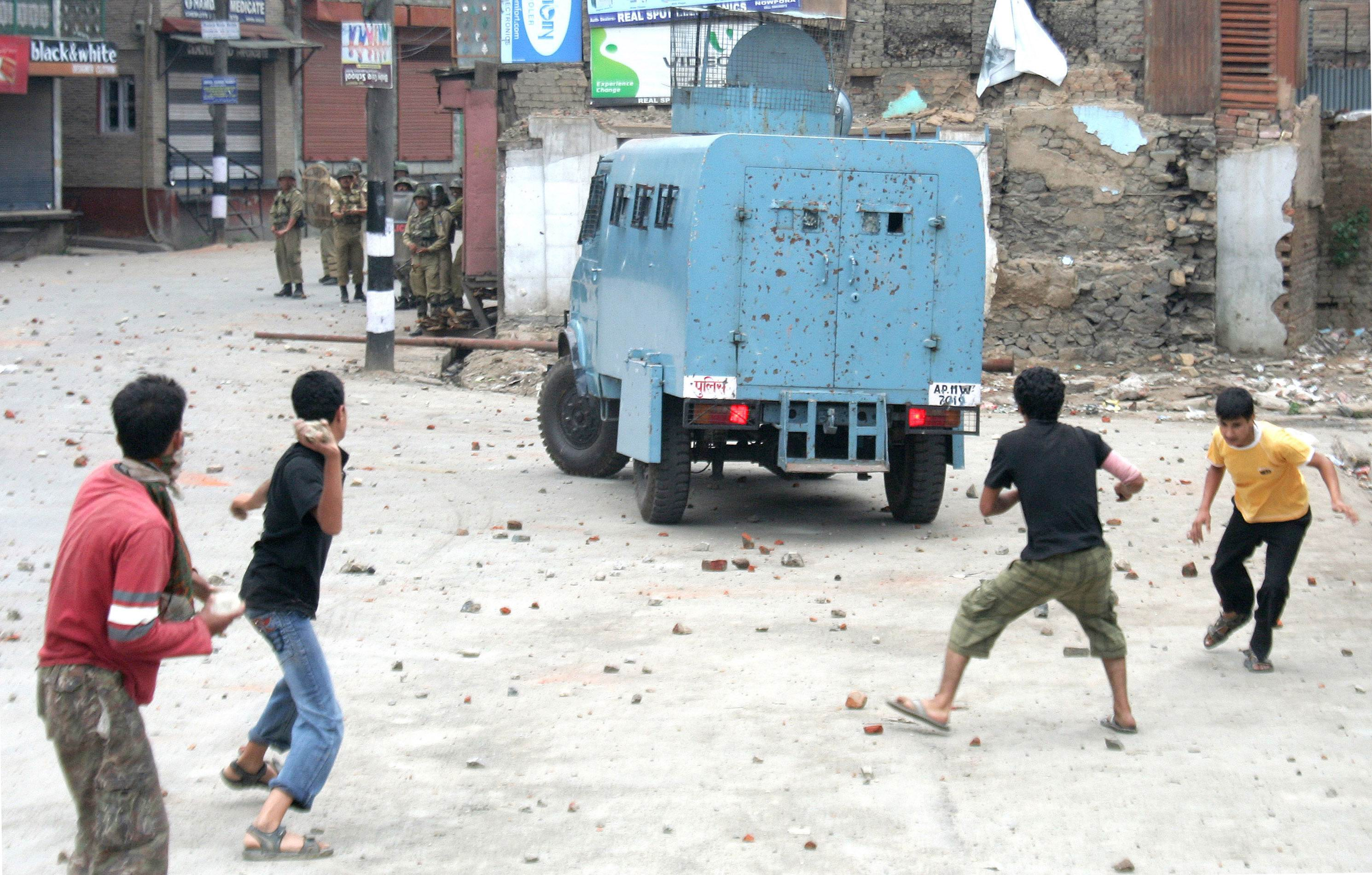 Protesters pelting a CRPF vehicle with stones . KT Photo:Imran Ali