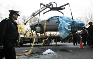 A car that was bombed by two assailants on a motorcycle in Tehran on Jan. 11, killing Iranian nuclear scientist Mostafa Ahamdi Roshan, is removed by a mobile crane. The photo was distributed by the semi-official Iranian photo agency Fars.