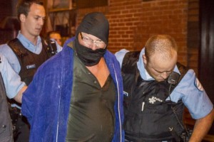 The PQ shooter under arrest on election night. (Photo: La Presse)