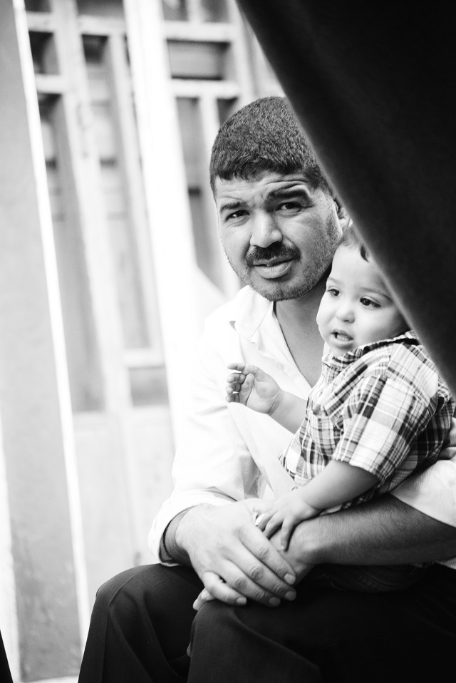 A man visits his baby boy at the refugee camp in La'ayoune