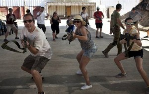 American tourists training with wooden guns during an introductory course to handle firearms at the Caliber 3 shooting range near the West Bank settlement of Efrat (photo: AFP)