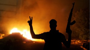 Libyan man flashes victory sign