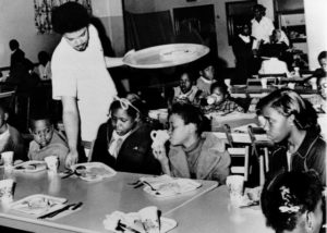 Bill Whitfield of the Black Panther chapter in Kansas City serves free breakfast to children before they go to school, April 16, 1969 (Source: National Geographic)