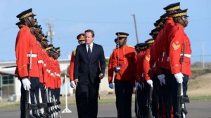 David Cameron greeted by an honour guard at the airport in Kingston. (Source: PA)