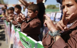 Palestinian children take part in a rally in front of the Red Cross headquarters in Gaza City marking Palestinian Prisoners Day  (Photo: REUTERS/Suhaib Salem)