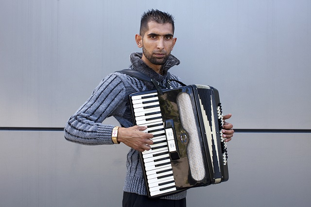 St Georges Cross, gold watch with Accordion © Mahtab Hussain - The Commonality of Strangers 2014