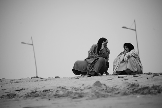 a mother and daughter sit discussing life in Sahrawi camp