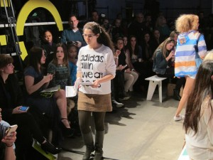 Caitlin McLaren protests worker exploitation in Adidas factories at New York Fashion Week