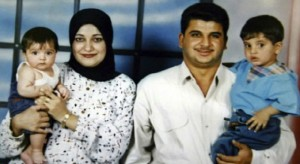 Baha Mousa, 26, with his wife and two children. The Iraqi hotel worker died after being detained by the British army for 36 hours (Photograph: Reuters)