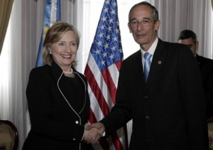 U.S. Secretary of State Hillary Clinton and Guatemala's President Alvaro Colom shake hands in Guatemala City