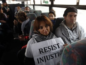 Two Palestinian Activists Sit Aboard A Jerusalem-Bound Bus In The West Bank. Credit: Ahmad Gharabli/AFP/Getty Images