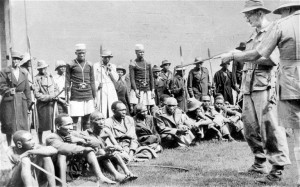 British soldiers guard Kenyan captives during the 1950s