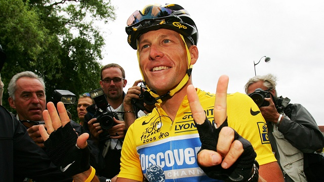 July 24, 2005 - Lance Armstrong celebrates his seventh Tour de France victory. He was stripped of all seven titles in 2012. (AP Photo/Alessandro Trovati, File)